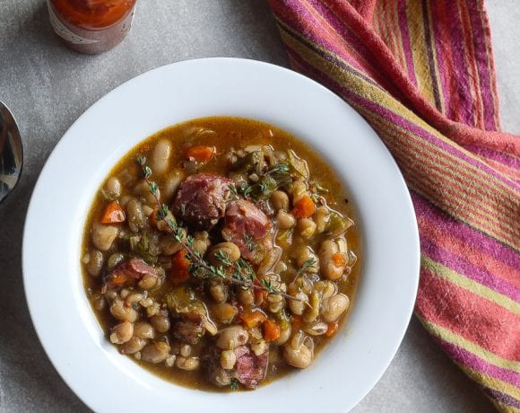 white bean stew with ham hocks in a bowl