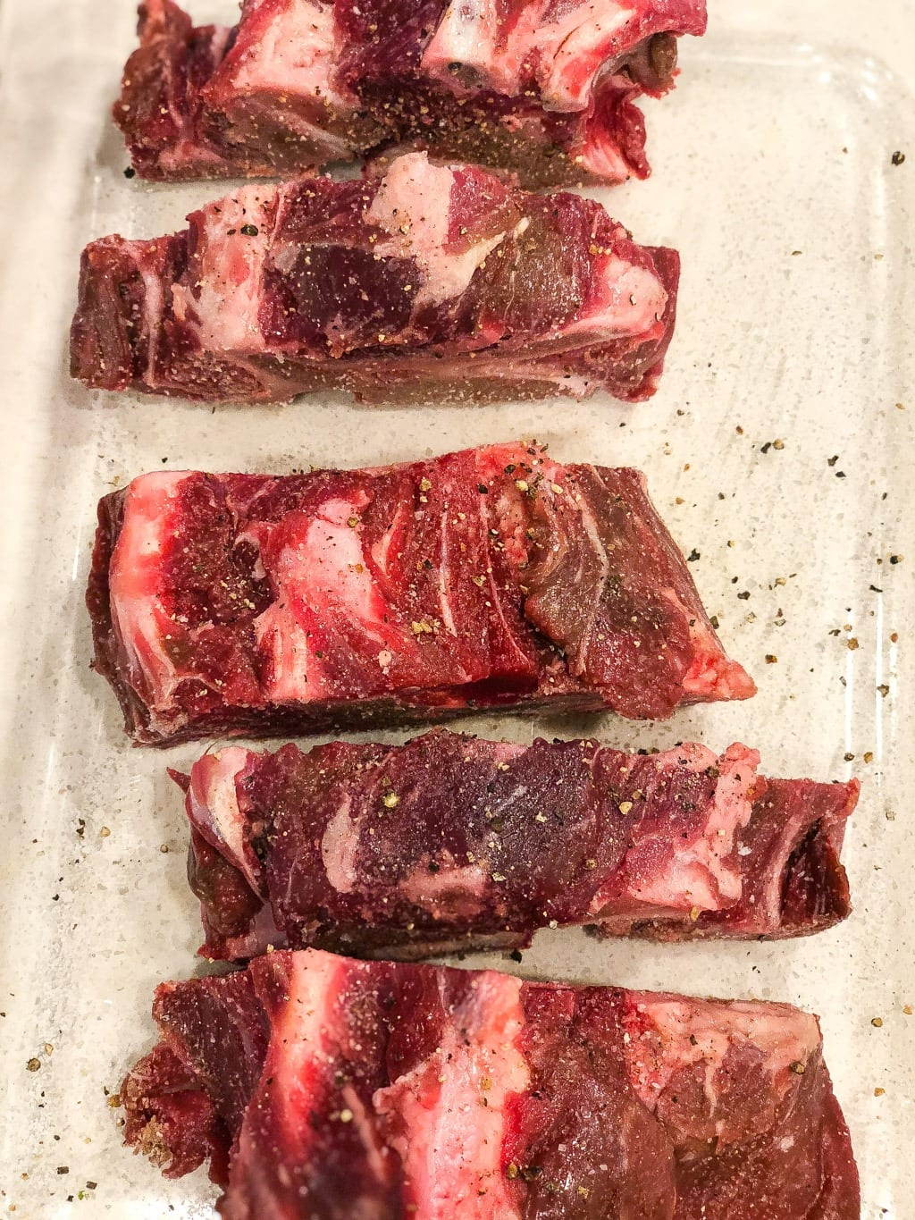 raw beef neck bones with salt and pepper