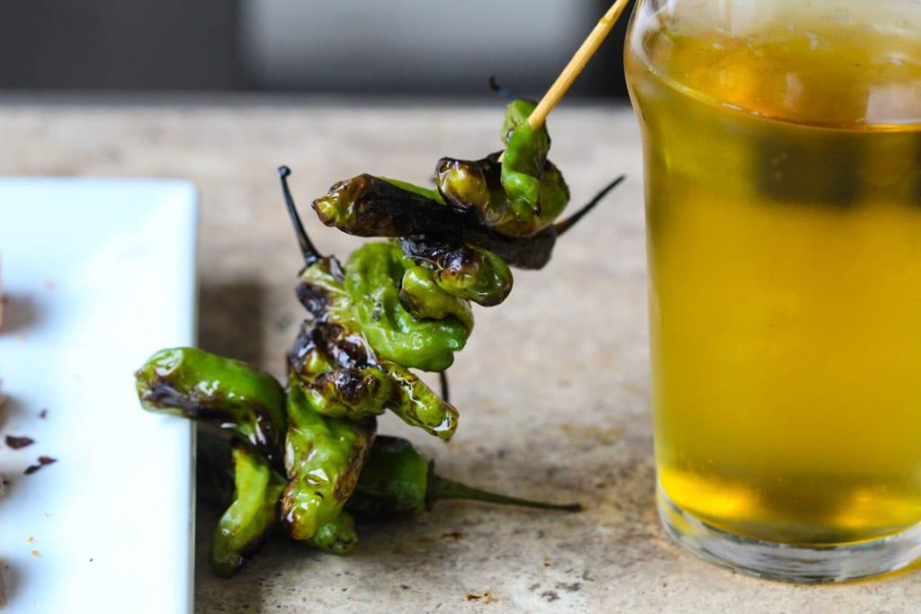 skewered shishito peppers