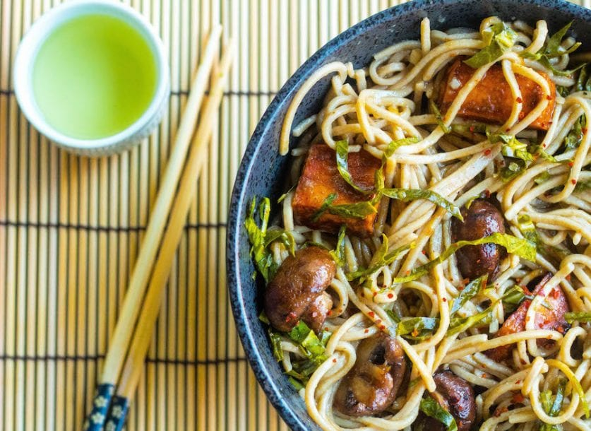 stir fried Soba Noodle bowl with roasted sweet potatoes, mushrooms, and collard greens.