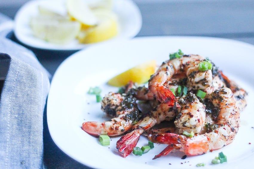 grilled piri piri shrimp on a plate with piri piri spices