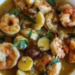 bowl of shrimp stew with potatoes and parsley #stew #shrimp www.foodfidelity.com
