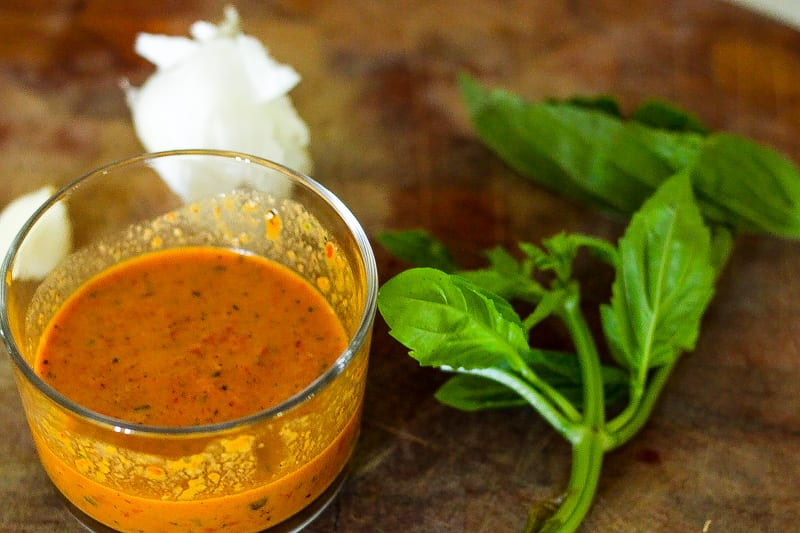jar of roasted red pepper sauce with basil and garlic on a cutting board #redpepper #sauce www.foodfidelity.com