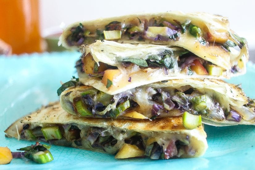brussels sprouts based vegetarian quesadillas stacked on a plate #quesadillas #brusselssprouts www.foodfidelity.com