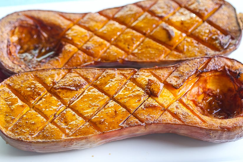 smoked butternut squash halves on a platter