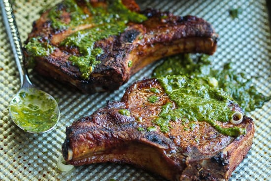 grilled puerto rican pork chops topped with chimichurri sauce
