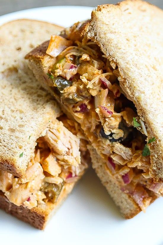 chicken salad sandwich halves on a plate