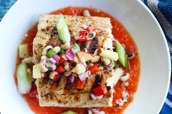 grilled mahi mahi in bowl with sauce and blackeyed pea salad