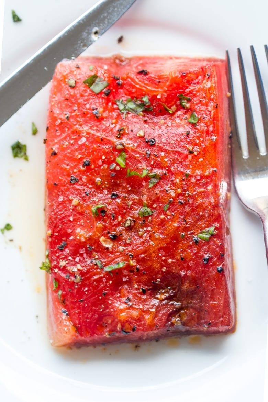 roasted watermelon steak on a plate.