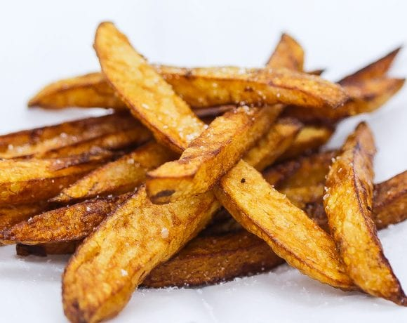 Belgian fries on a white platter