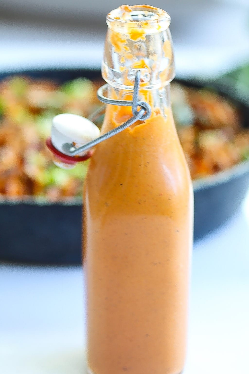 bottled roasted red pepper sauce with pan in the background
