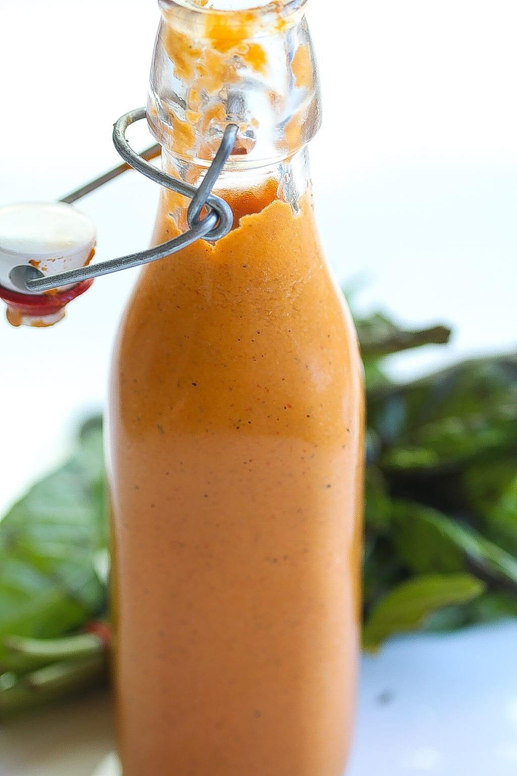 bottled roasted tight shot of red pepper sauce with basil