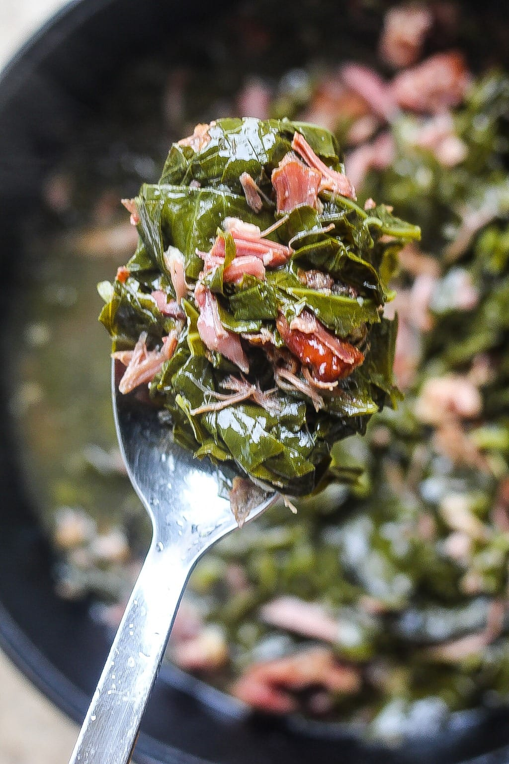 forkful of southern collard greens with smoked turkey