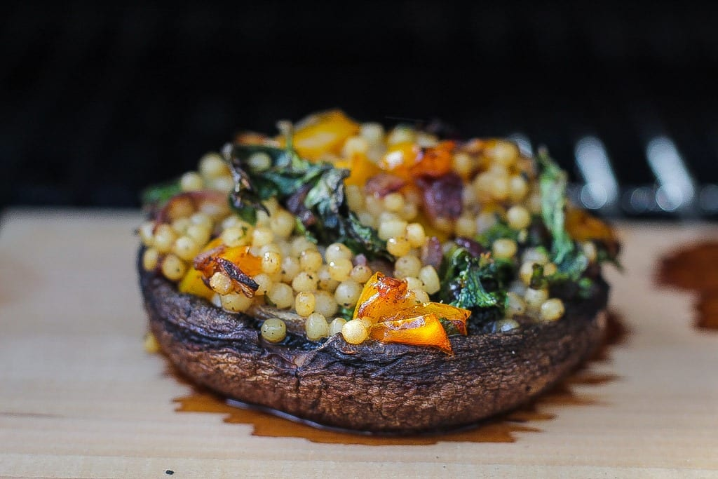 vegan smoked and stuffed portobello mushrooms with kale and couscous