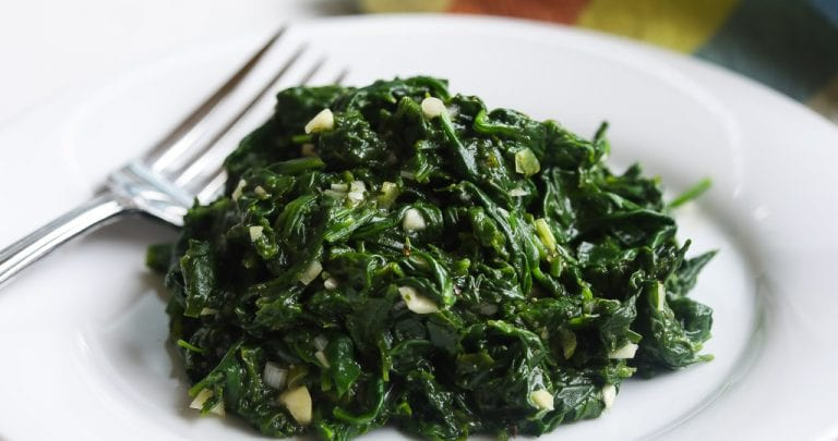 blanched spinach side dish in a bowl